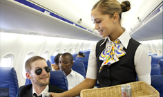 Cabin Attendent Serving Drinks on SA Express Flight